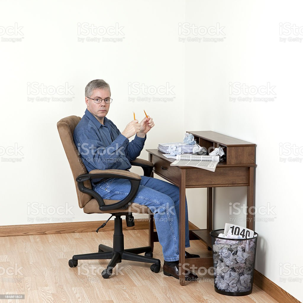 Man working on taxes royalty-free stock photo