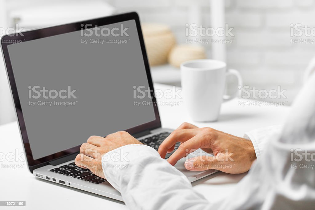 Man working on the laptop stock photo