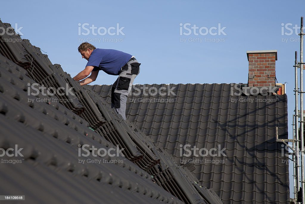 Man working on the roof. royalty-free stock photo