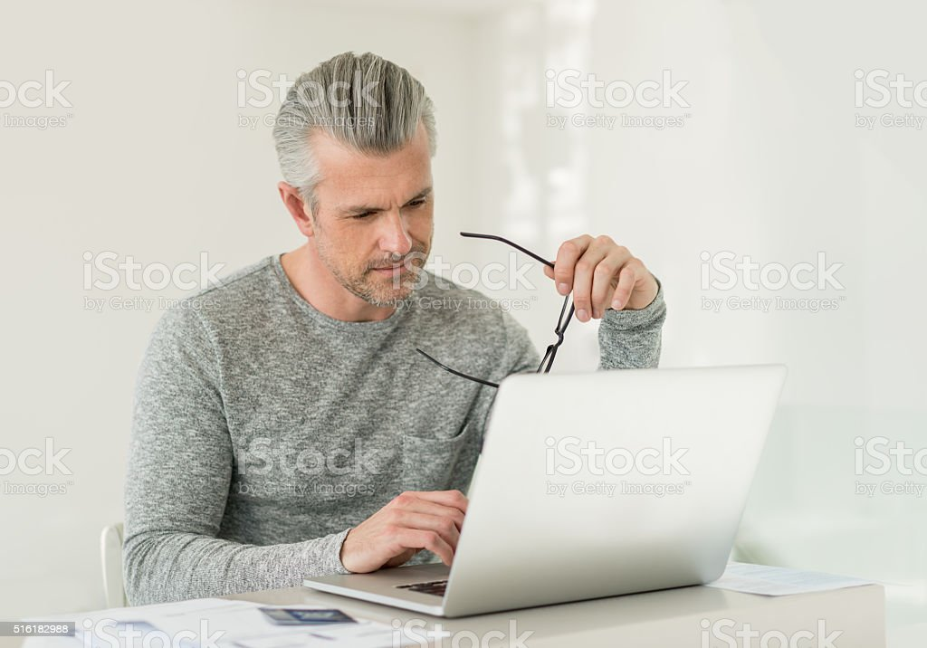 Man working online at home stock photo