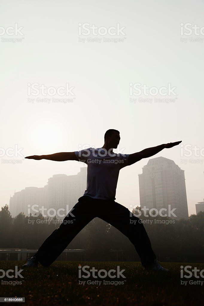 Man working out in park stock photo