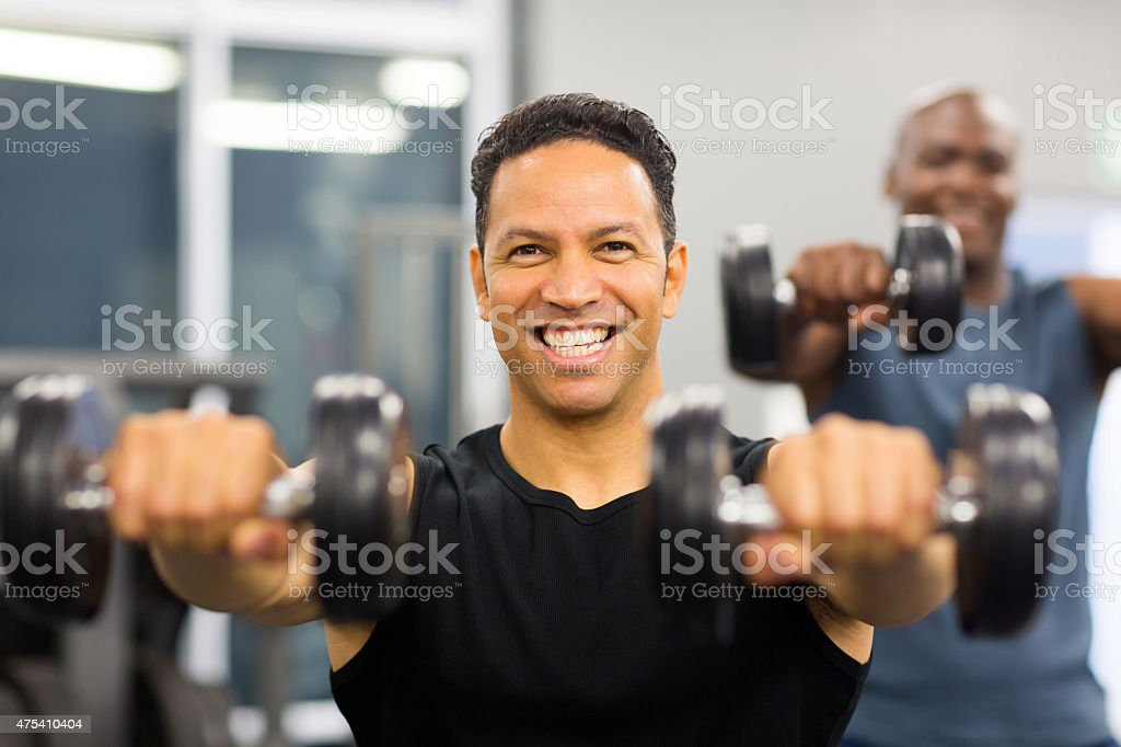 man working out with dumbbells stock photo