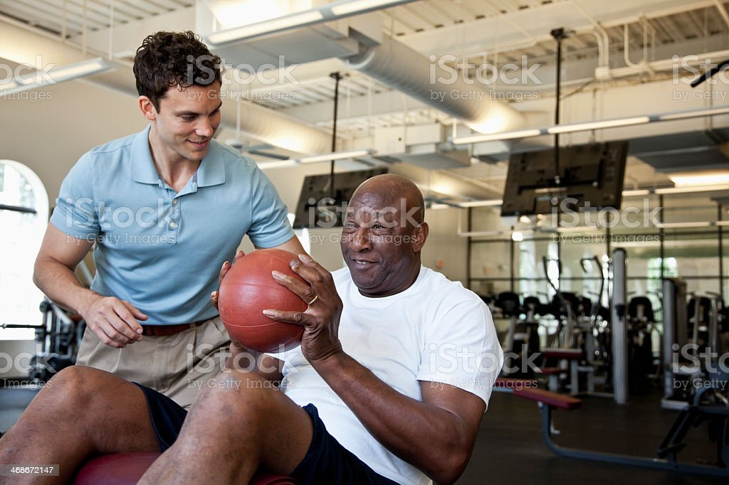Man working out with fitness ball stock photo