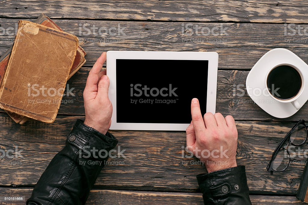 man working outside the office using a tablet computer stock photo