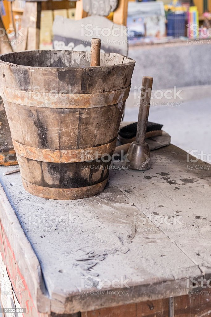 man working stone and tools stock photo