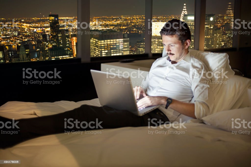 Man working until late in New York stock photo