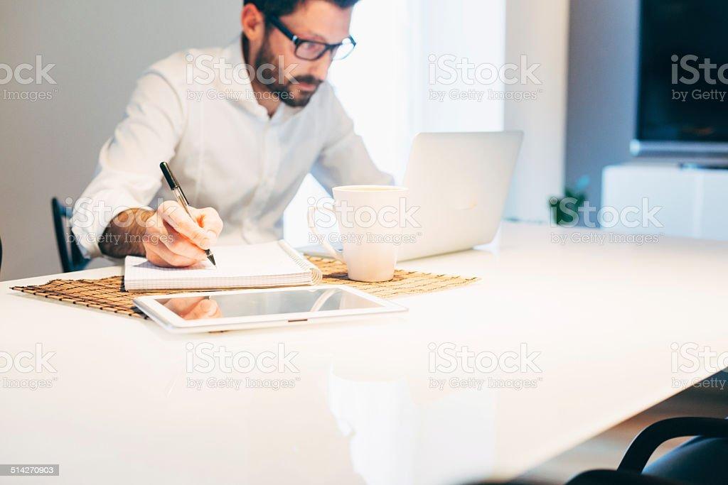 Man working using laptop at home stock photo