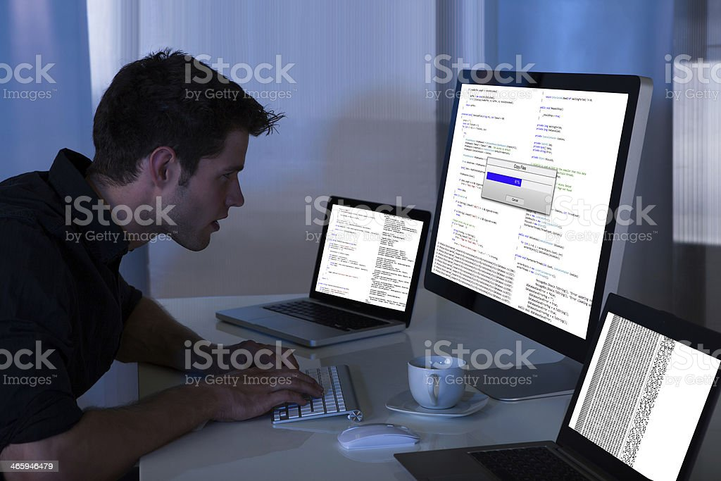 Man Working With Computer And Laptop stock photo