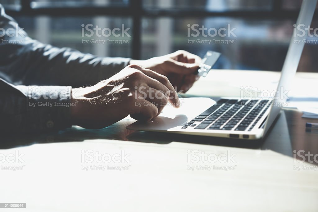 Man working with generic design notebook. Online payments plastic card stock photo