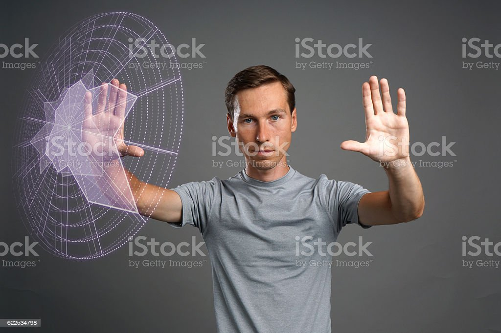 Man working with interactive Sci-Fi HUD interface. stock photo
