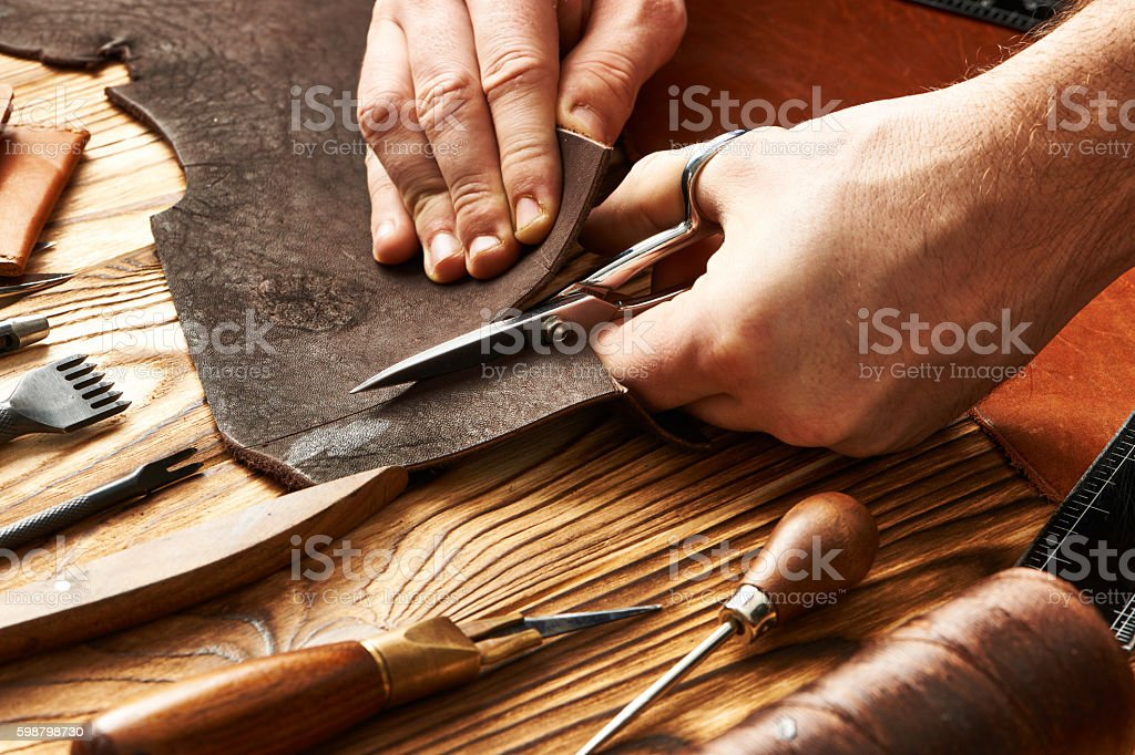 Man working with leather stock photo