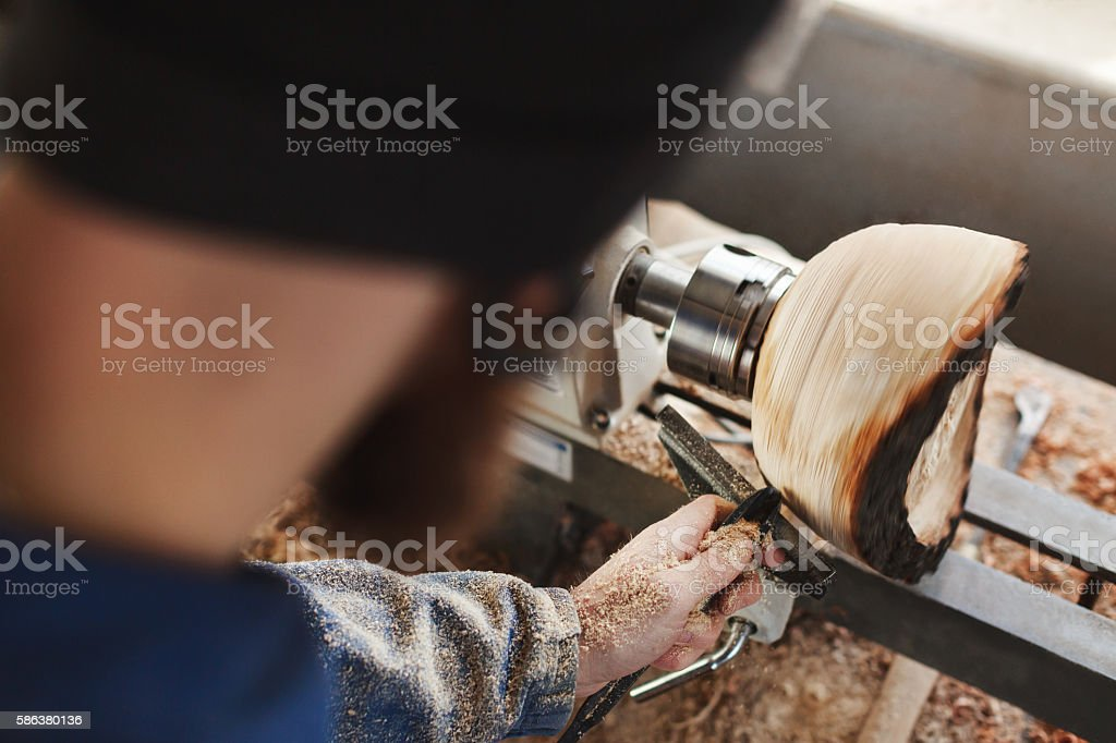 man working with woodcarving instruments stock photo