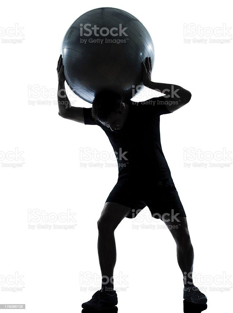 man workout holding fitness ball stock photo