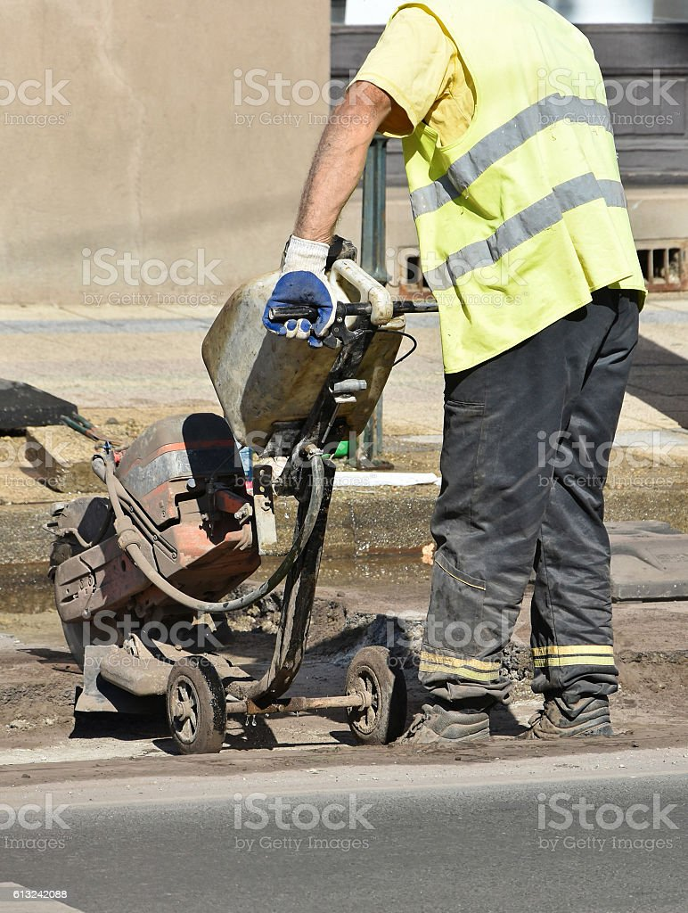 Man works on the road construction stock photo