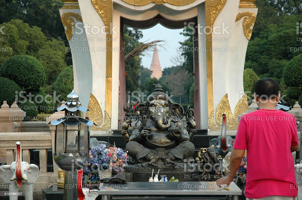 Man Worship Ganesh Memorial stock photo