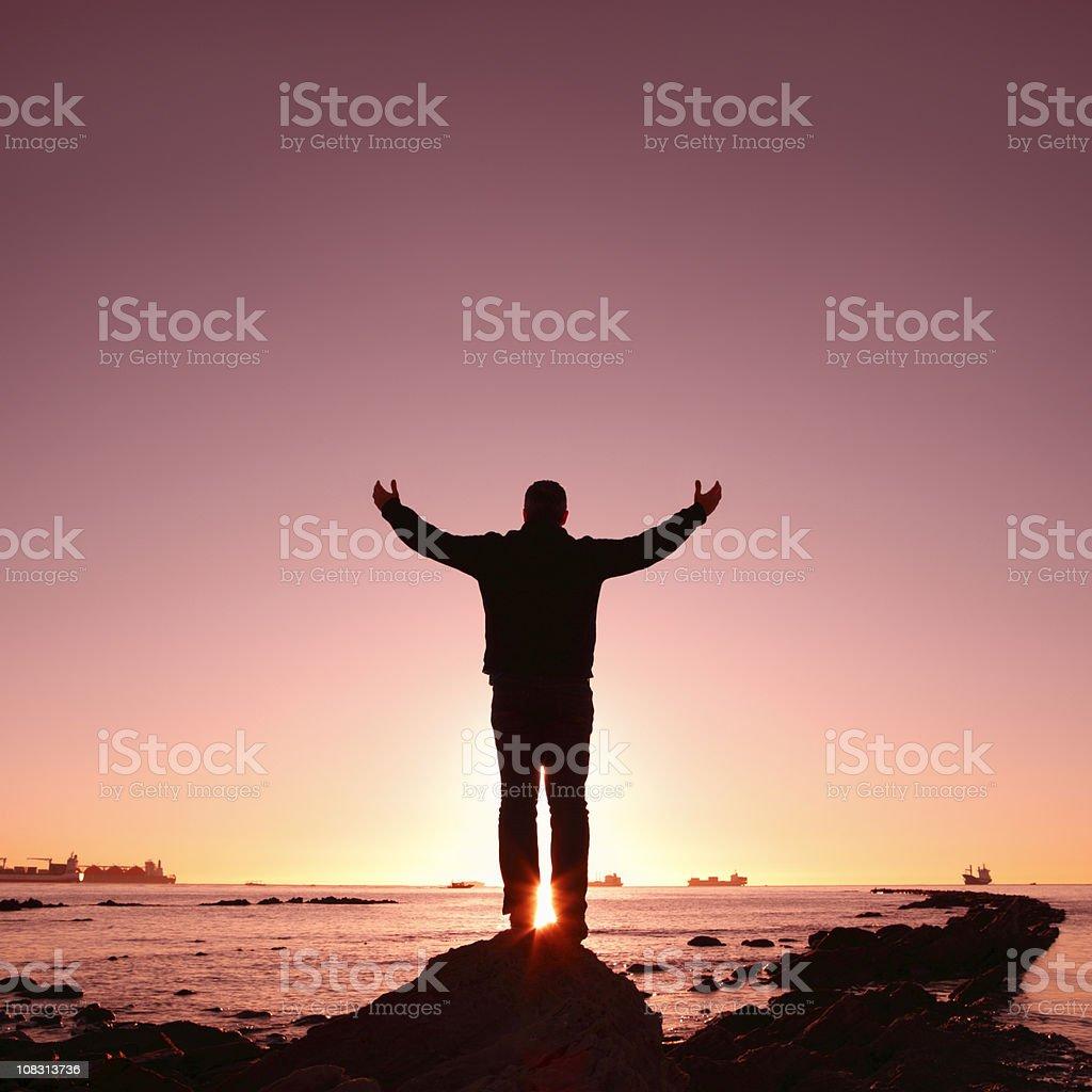 Man Worshipping at Sunrise royalty-free stock photo