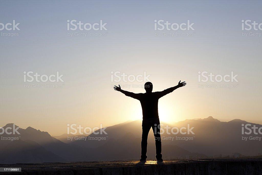 Man Worshipping at Sunrise stock photo