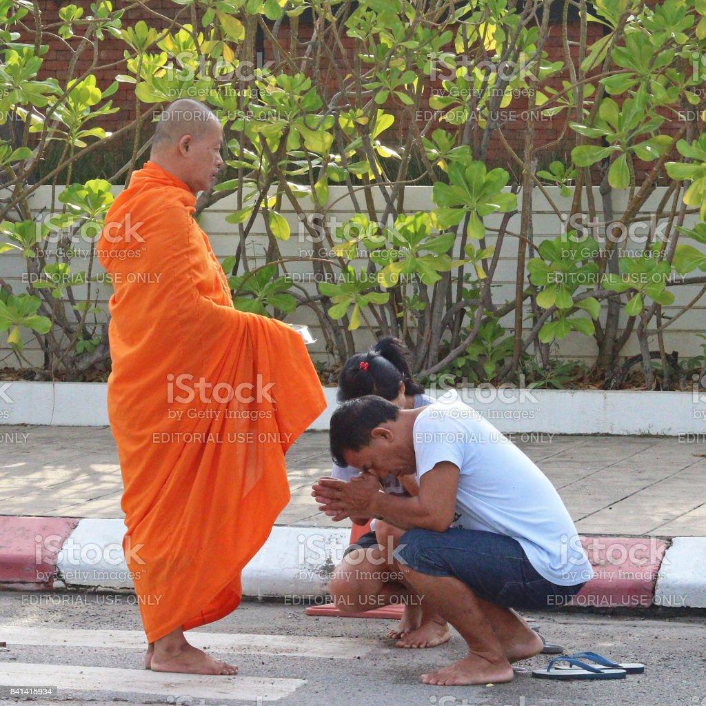 Man worships monk in Thailand stock photo