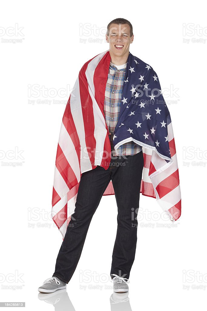 Man wrapped in an American flag stock photo