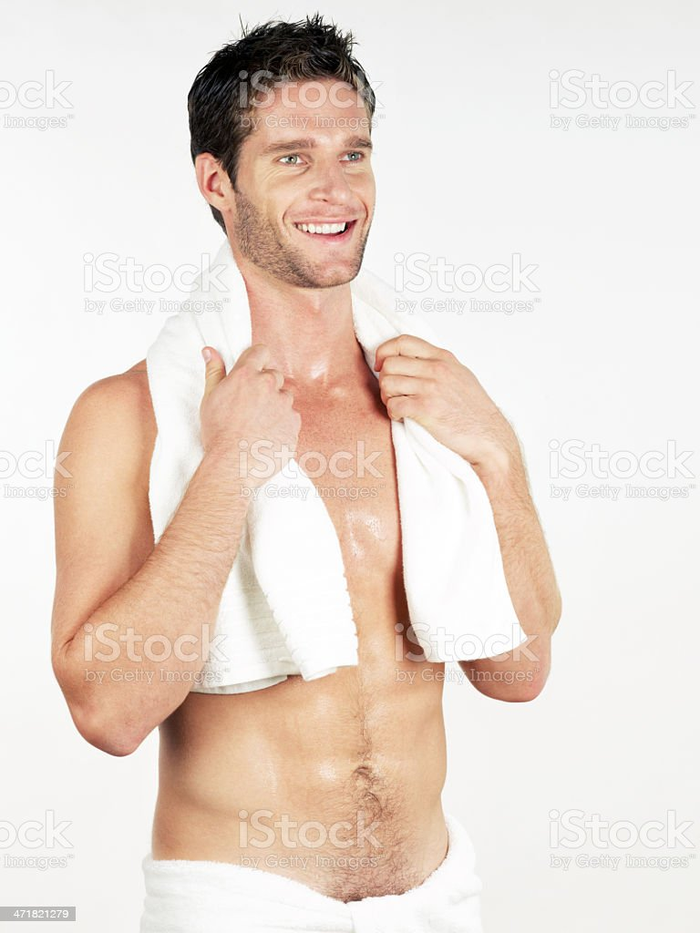 Man wrapped in bath towel smiling royalty-free stock photo