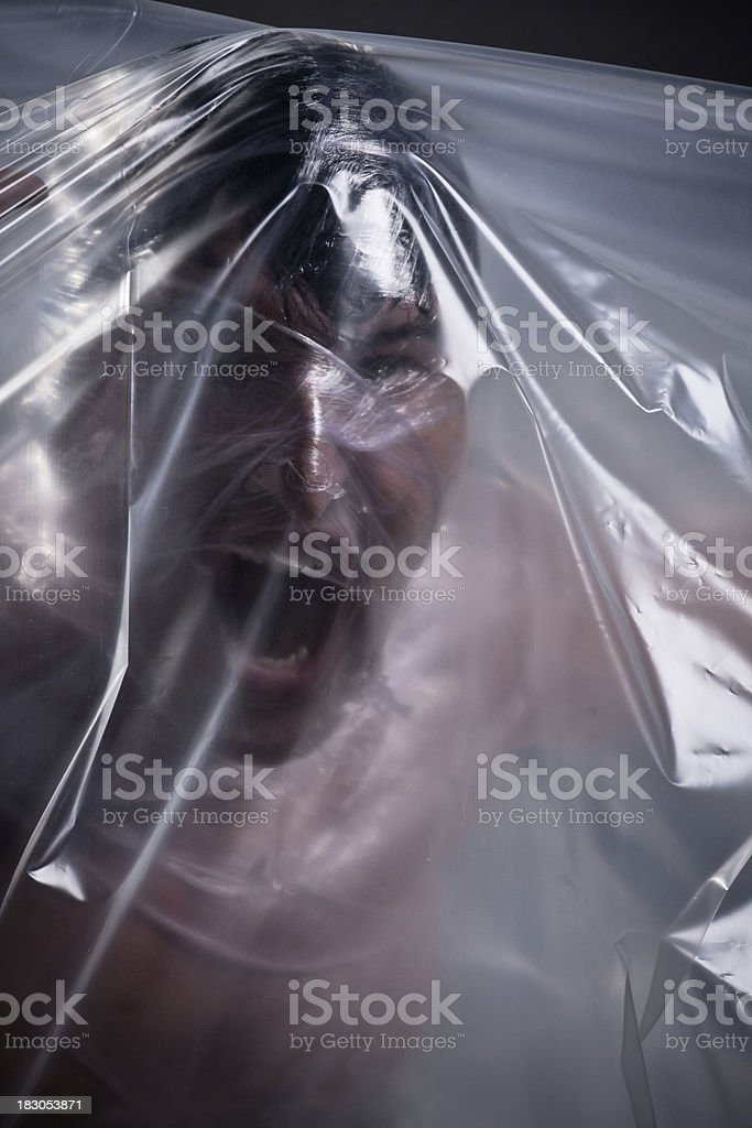 Man wrapped in plastic film. stock photo