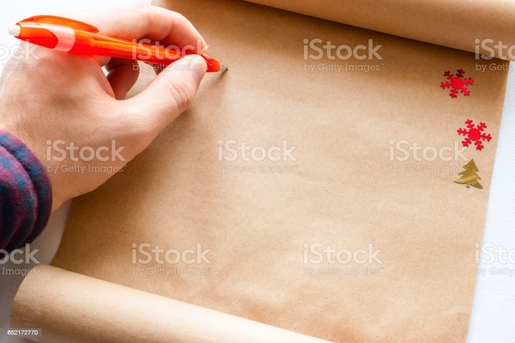 man writes in the scroll close-up stock photo