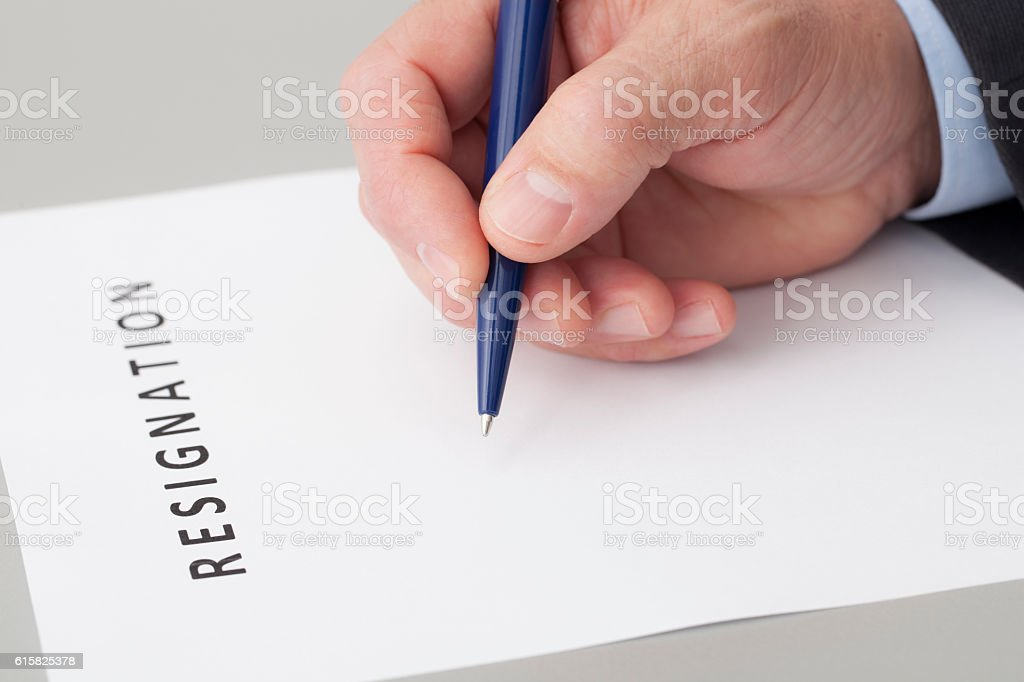 Man Writing a Letter of Resignation stock photo