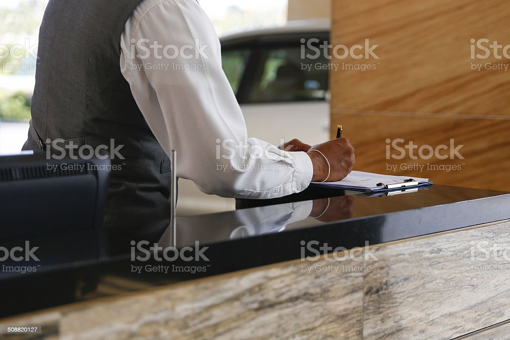 Man writing a note stock photo