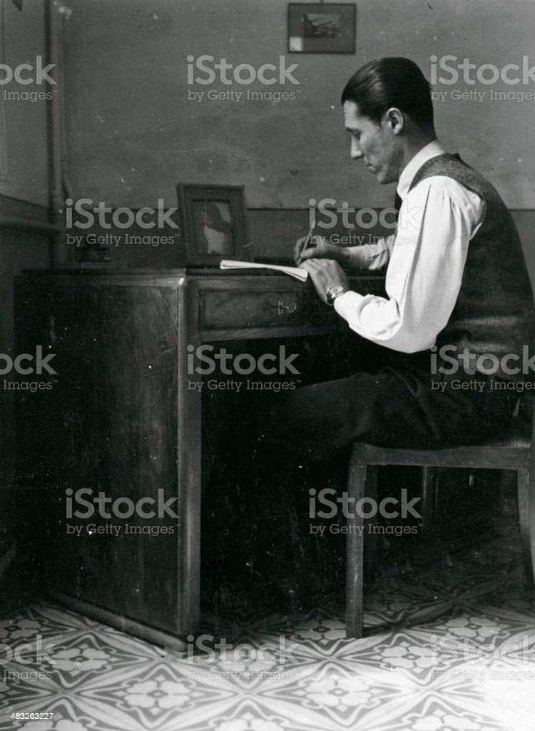 Man Writing at Desk in 1940,Black And White royalty-free stock photo