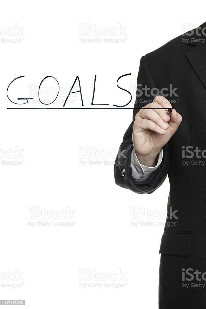 Man Writing Goals on Transparent Surface from Behind royalty-free stock photo