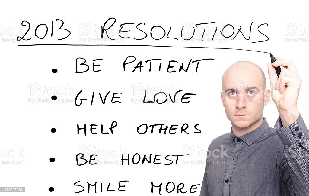 man writing his 2013 resolutions royalty-free stock photo