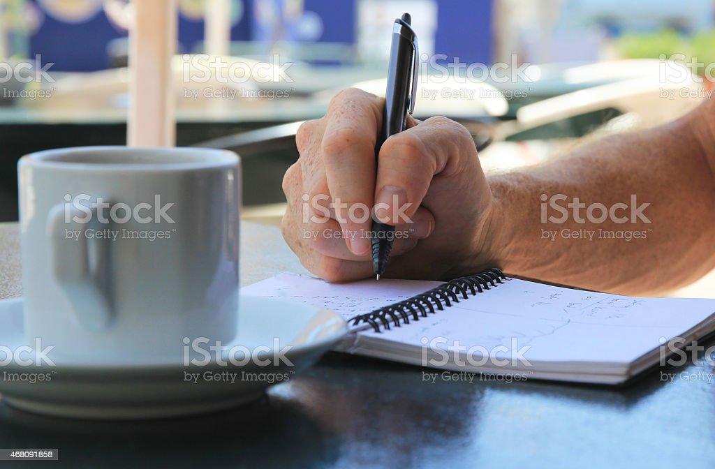 Man writing ideas stock photo