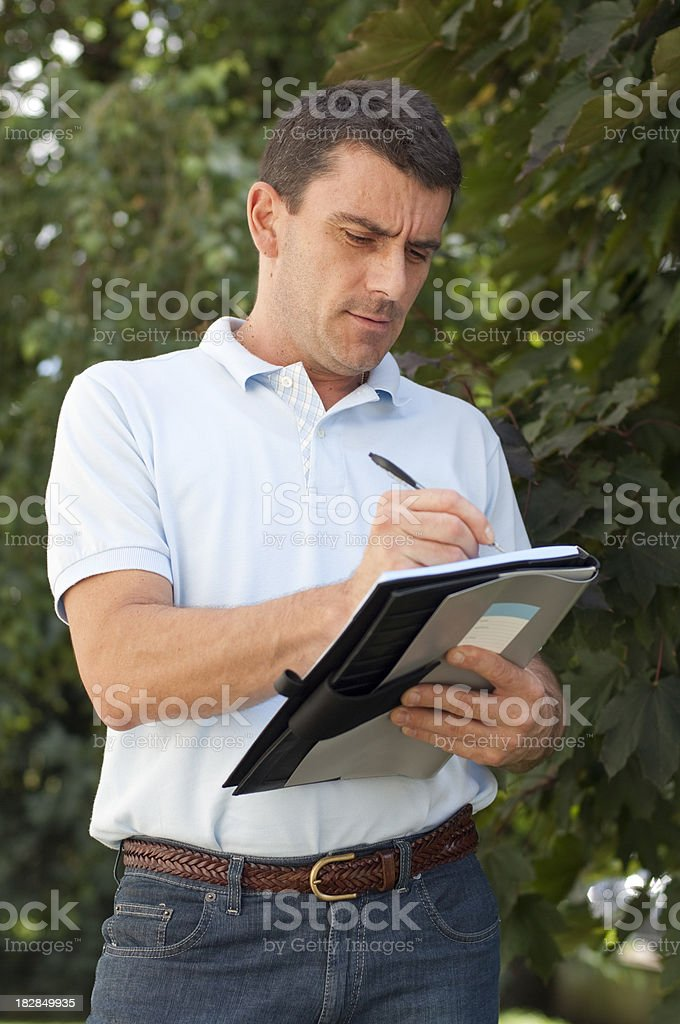 Man Writing on a Notebook royalty-free stock photo