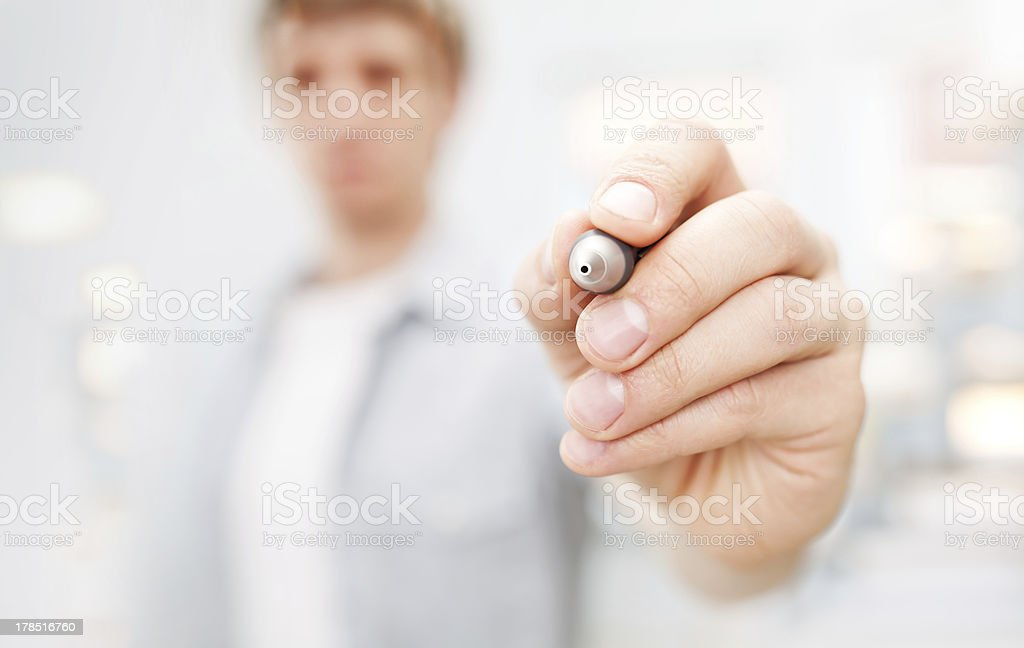Man writing on glass board or working with virtual screen royalty-free stock photo