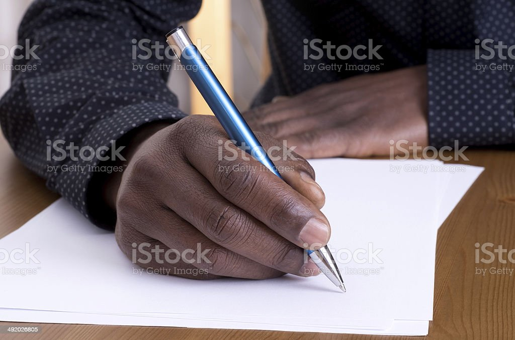Man writing with a pen stock photo