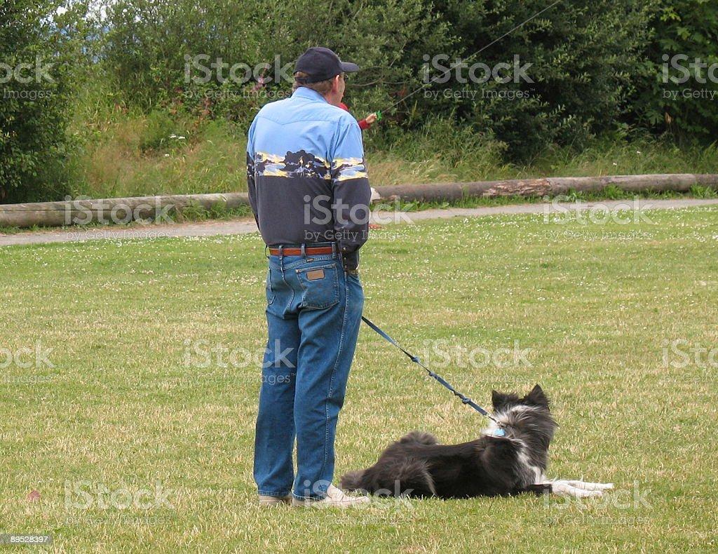 Man yawning with dog royalty-free stock photo