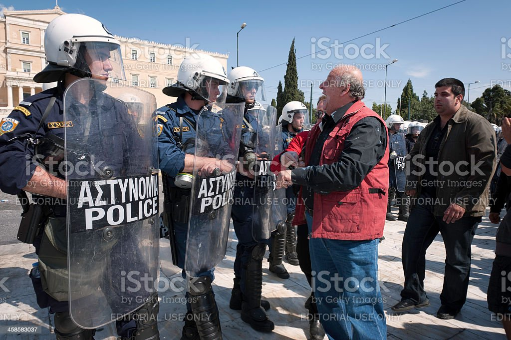 Man Yelling at Greek Riot Police stock photo