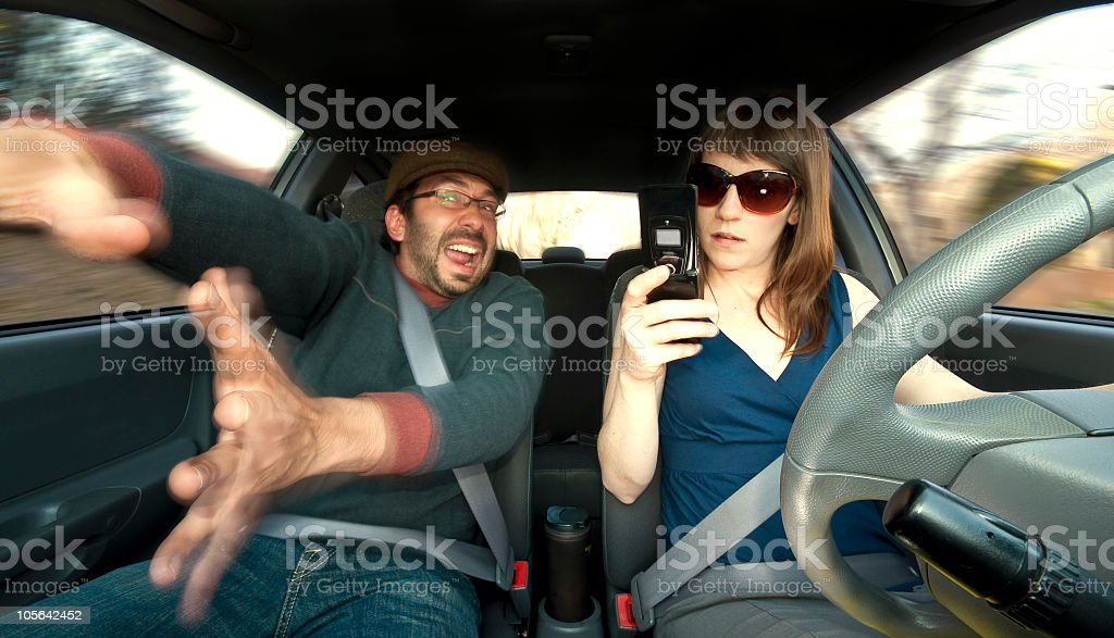 Man yelling at woman driver on phone royalty-free stock photo