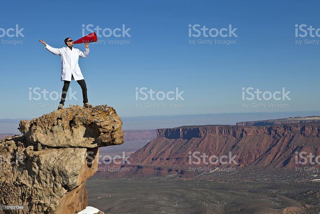 Man yelling into canyon royalty-free stock photo