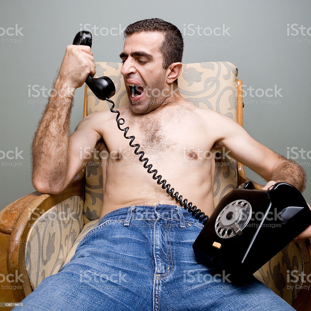 Man Yelling Into Telepone royalty-free stock photo
