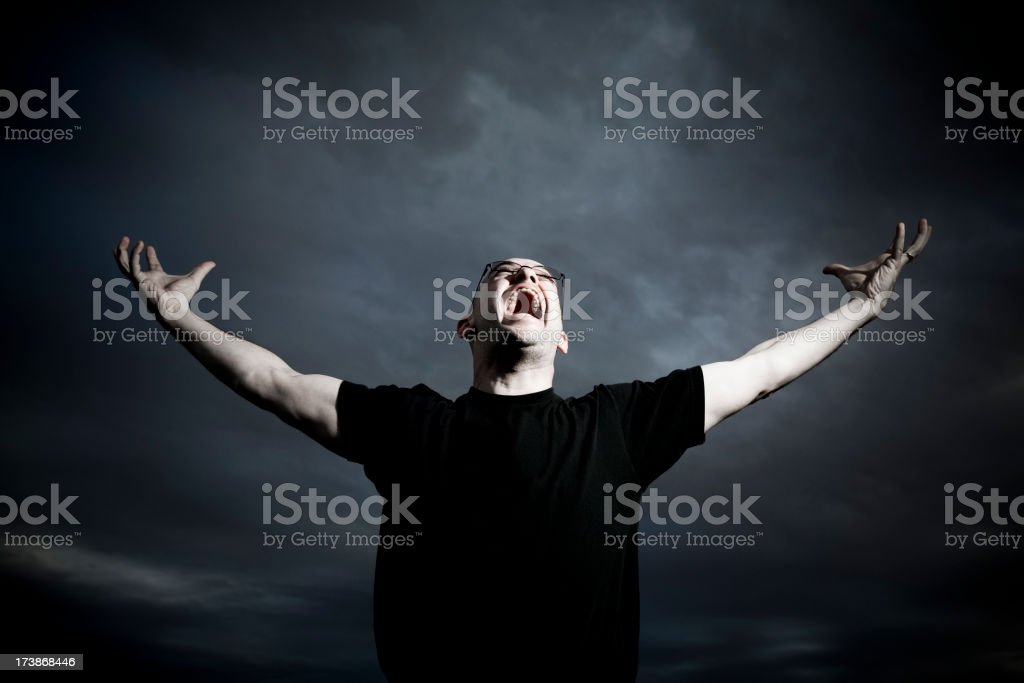 Man Yelling into the Sky royalty-free stock photo