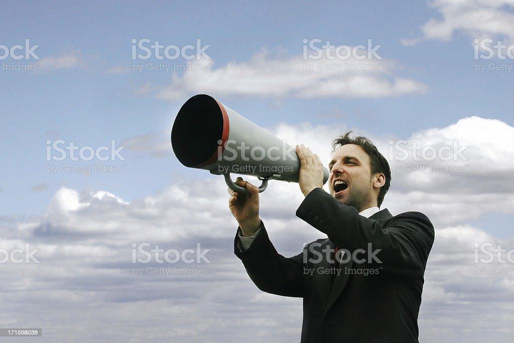 Man yelling trough a megaphone II royalty-free stock photo