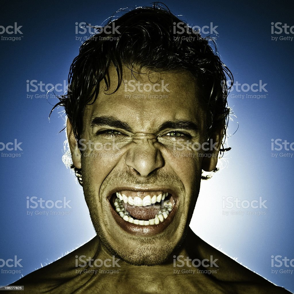 Man Yelling with Blue Sky in Background royalty-free stock photo
