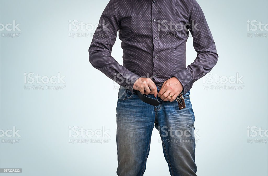 Man zip his pants up after peeing stock photo