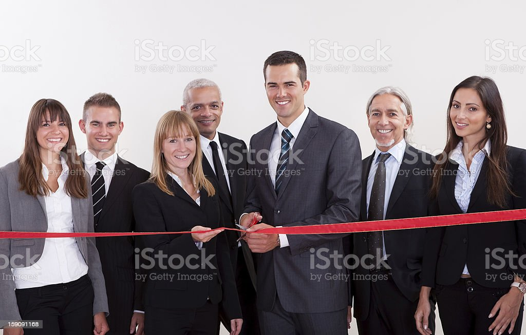 Management about to cut the red ribbon stock photo