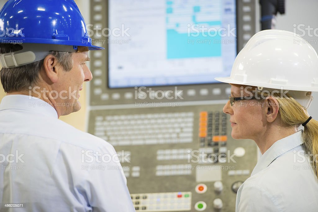 Manager And Engineer Programming A CNC stock photo