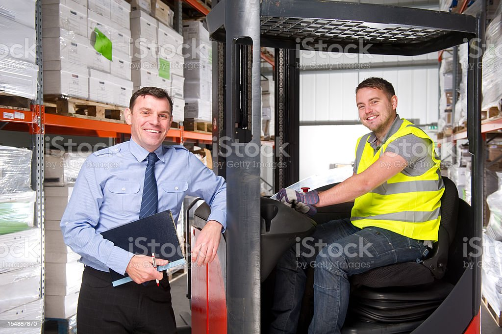 Manager and Forklift Operator royalty-free stock photo