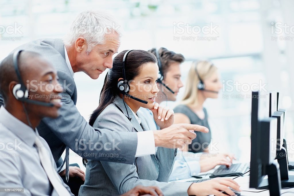 Manager and his team working in a call center stock photo