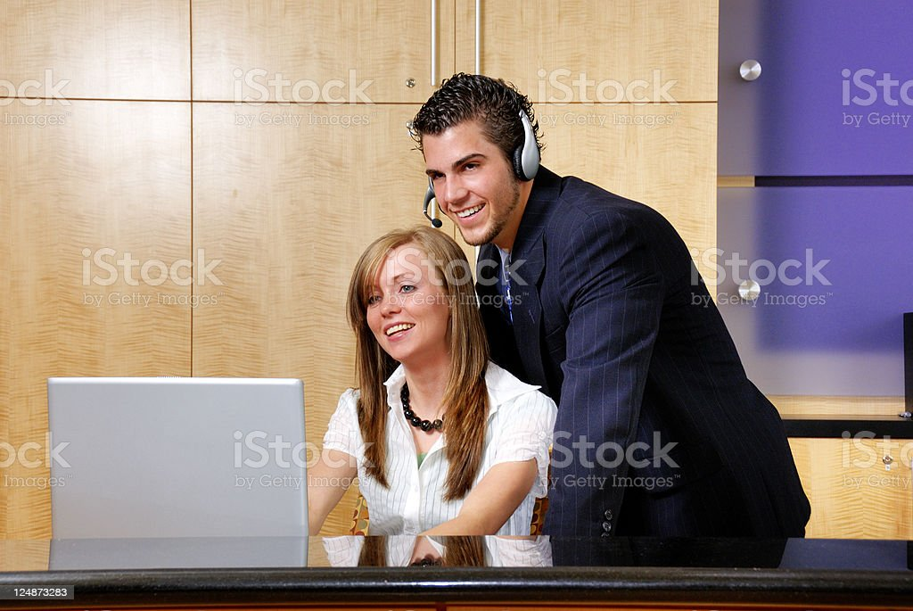 Manager and Secretary Working At The Office royalty-free stock photo