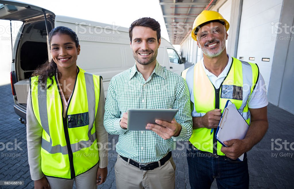 Manager and workers are smiling and posing to the camera stock photo